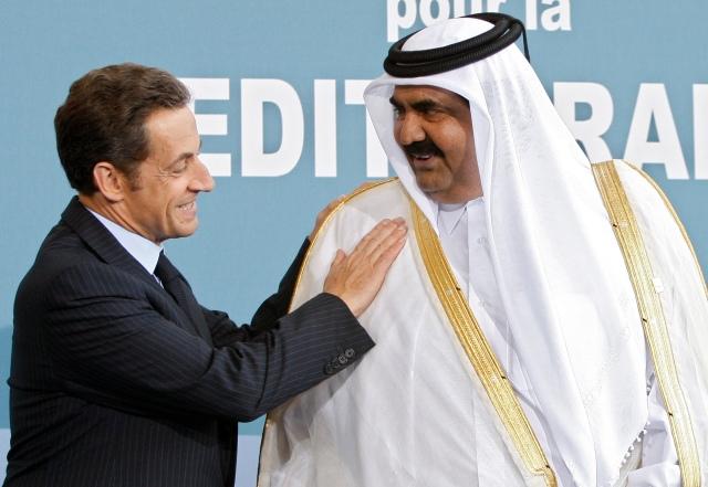 France's President Nicolas Sarkozy greets Qatar's Emir Sheikh Hamad bin Khalifa al-Thani upon his arrival at the EU-Mediterranean summit in Pari