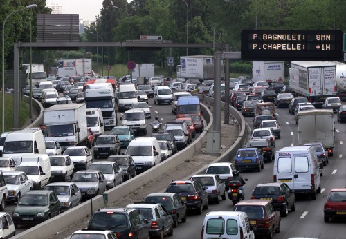 Cars and trucks are shown jammed on the Paris ring road June 3. Workers on the Paris metro railway s..