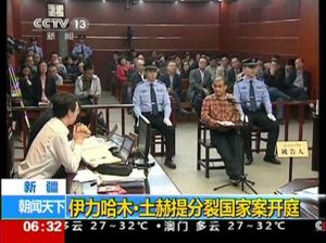acine-ilham-tohti-sits-in-a-chair-at-the-stand-during-his-trial-on-separatism-charges-in-u