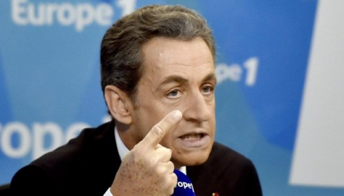 "Head of the French right-wing opposition UMP party, Nicolas Sarkozy speaks during an interview at the Europe 1 radio station studio on February 19, 2015 in Paris. Sarkozy excluded any agreement with the FN and said that his candidacy for the 2017 presidential election was not ""mandatory"".   AFP PHOTO / DOMINIQUE FAGET"