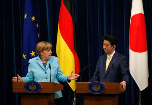 Germany's Chancellor Angela Merkel and Japan's Prime Minister Shinzo Abe attend their joint news conference after talks at Abe's official residence in Tokyo