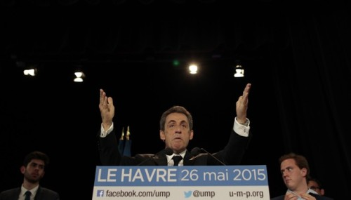 The president of the French right-wing UMP opposition party, Nicolas Sarkozy gestures during a meeting on May 26, 2015 in Le Havre, northwestern France . AFP PHOTO/CHARLY TRIBALLEAU