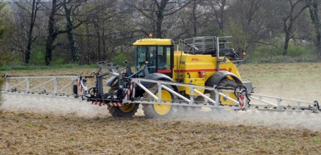 A farmer sprays pesticides onto a field in Villefranche-de-Lauragais, southwestrn France, on  April 3, 2015. AFP PHOTO / REMY GABALDA