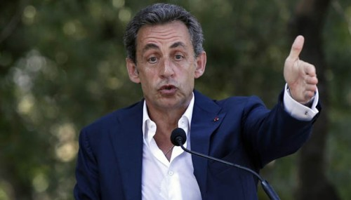 Former French President Nicolas Sarkozy delivers a speech during a meeting with right-wing Les Republicains party members, on July 19, 2015 in Nice, southeastern France. AFP PHOTO / VALERY HACHE