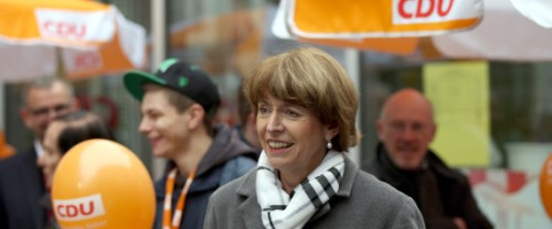 """Picture taken on October 16, 2015 shows Henriette Reker, a prominent candidate for the mayoral election in Cologne, campaigning in Cologne, western Germany. Reker suffered serious stab wounds to the neck during an assault on October 17, 2015 in Cologne. German police said the stabbing of Reker had a """"racist political"""" motive linked to the huge numbers of migrants entering the country.     AFP PHOTO / DPA / OLIVER BERG   +++   GERMANY OUT   +++"""