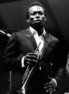 UNITED STATES - JULY 02:  NEWPORT JAZZ FESTIVAL  Photo of Miles DAVIS, Performing live onstage - looking to camera.  (Photo by David Redfern/Redferns)