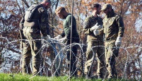 des-soldats-slovenes-installent-des-barbeles-le-11-novembre_998815_500x286