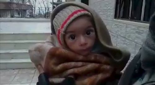 aMadayaa-toddler-is-held-up-to-the-camera-in-this-still-image-taken-from-video-said-to-be-shot-in-madaya_5495944