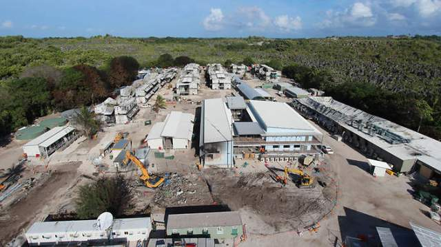 Supplied overview image obtained Thursday, Aug. 15, 2013 of destroyed buildings at Nauru immigration detention centre in Nauru, Saturday, July 20, 2013. Canstruct, the company constructing the Nauru Regional Processing Centre says the rebuilding of the complex is happening ?in record time? following the riot which took place on Friday, July 19, 2013. (AAP Image/Canstruct) NO ARCHIVING, EDITORIAL USE ONLY