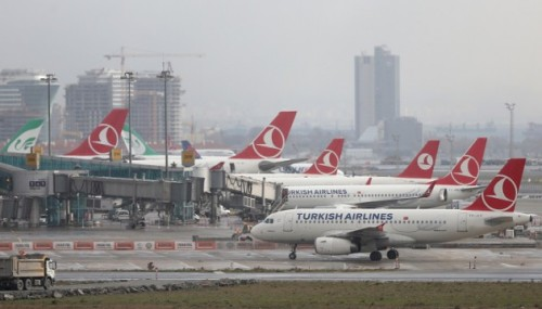 """ISTANBUL, TURKEY - DECEMBER 30: Turkish Airlines planes are docked at a terminal at Ataturk Airport in Istanbul, Turkey on December 30, 2015, after announcement of further flight cancellations due to adverse weather. Turkish Airlines cancelled more than 140 flights due to bad weather conditions predicted in the Istanbul area. In a statement on its website, the flag carrier said 142 domestic and international flights would be cancelled from Istanbul's Ataturk and Sabiha Gokcen airports on December 30-31 due to """"potential capacity reduction"""" caused by heavy snow. Berk Ozkan / Anadolu Agency"""