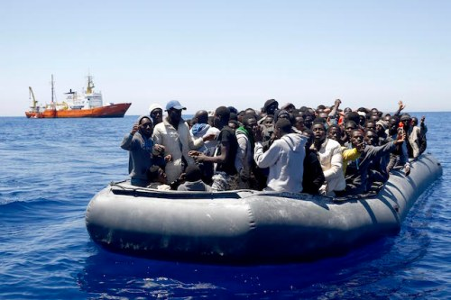 Central Mediterranean/May 16,2016. Search and Rescue team of SOS MEDITERRANEE evacuate African migrants from an overcrowded dinghy during an operation in Mediterranean sea 51 miles Northeast of Tripoli, Libya. Giorgos Moutafis/SOS MEDITERRANEE