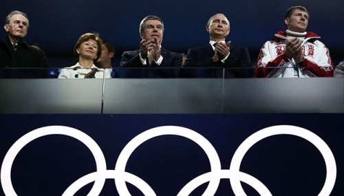 Russian President Vladimir Putin, right, and International Olympic Committee President Thomas Bach watch the closing ceremony of the 2014 Winter Olympics, Sunday, Feb. 23, 2014, in Sochi, Russia. (AP Photo/Charlie Riedel)/OLY122/154282507834/1402231743