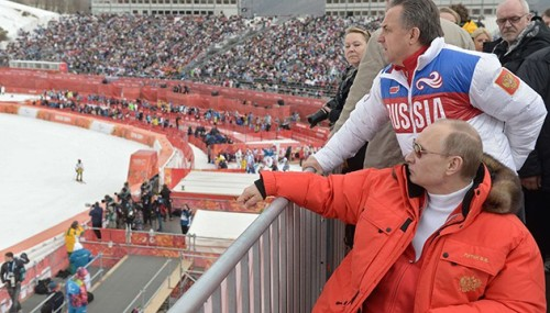 FILE - In this file photo taken Saturday, March 8, 2014, Russian President Vladimir Putin, foreground, watches downhill ski competition of the 2014 Winter Paralympics in Roza Khutor mountain district of Sochi, Russia, as Russia's sports minister Vitaly Mutko stands behind. On Monday, July 18, 2016 WADA investigator Richard McLaren confirmed claims of state-run doping in Russia. (AP Photo/RIA-Novosti, Alexei Nikolsky, Presidential Press Service)/FOS105/16200480461831/FILE POOL PHOTO TAKEN SATURDAY, MARCH 8, 2014/1607181535