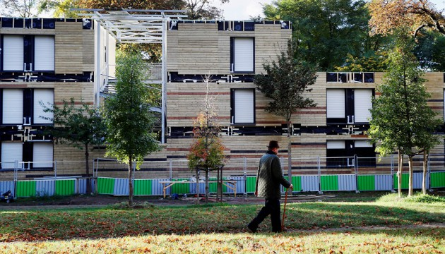 A picture taken on October 17, 2016 on the edge of the Bois de Boulogne in the 16th arrondissement of the French capital Paris shows the construction site of a housing centre for homeless people. The centre was affected by an arson today, but the controversial housing centre for homeless people is set to open as scheduled on November 5, 2016. / AFP PHOTO / Thomas SAMSON