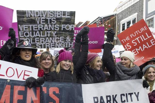 Jennifer Beals (L), Chelsea Handler (C L) and Charlize Theron (2nd R) participate in the Women's March on Main Street during the 2017 Sundance Film Festival in Park City, Utah, January 21, 2017. / AFP PHOTO / VALERIE MACON
